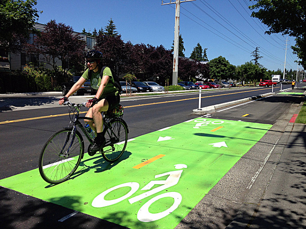 Modular curbs and bollards protect a bike lane in Seattle. Image: People for Bikes via WalkDenver
