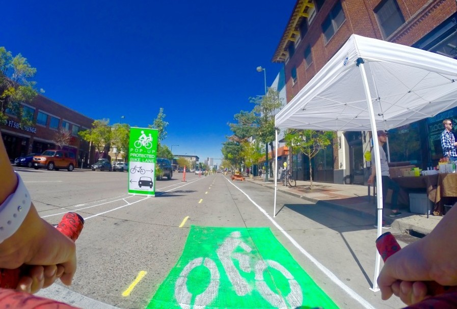 "A bike rider tests out the temporary ""pop-up"" bike lane on Broadway in September. Photo: BikeDenver"