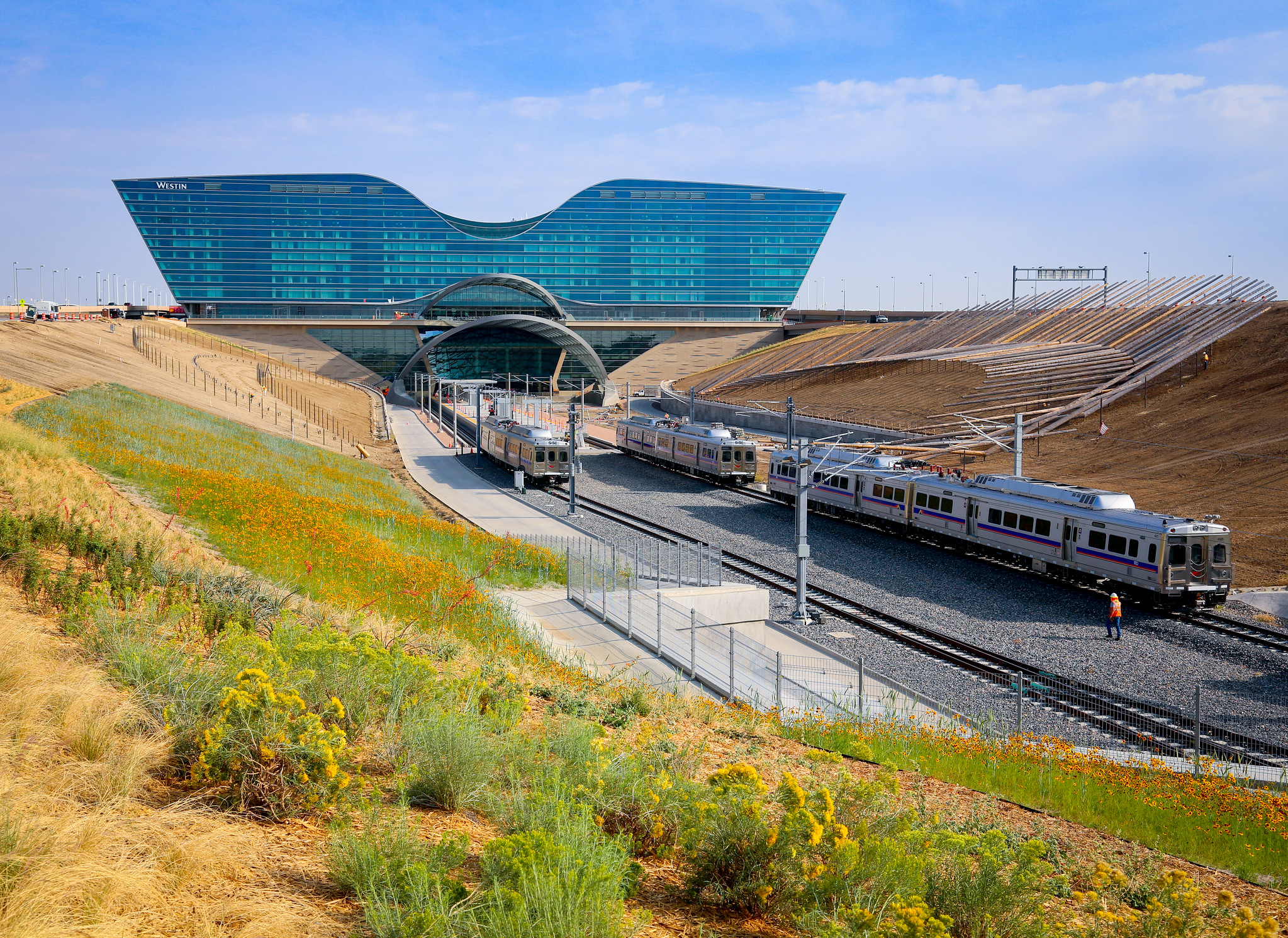 RTD A Line trains approach the airport transit center. Image: Denver International Airport